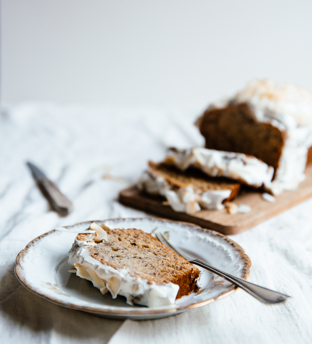 Cardamom & cocoa nib banana bread with coconut frosting