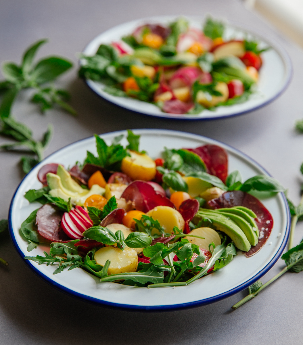 Summer potato salad with bresaola, tomatoes, radishes & avocado