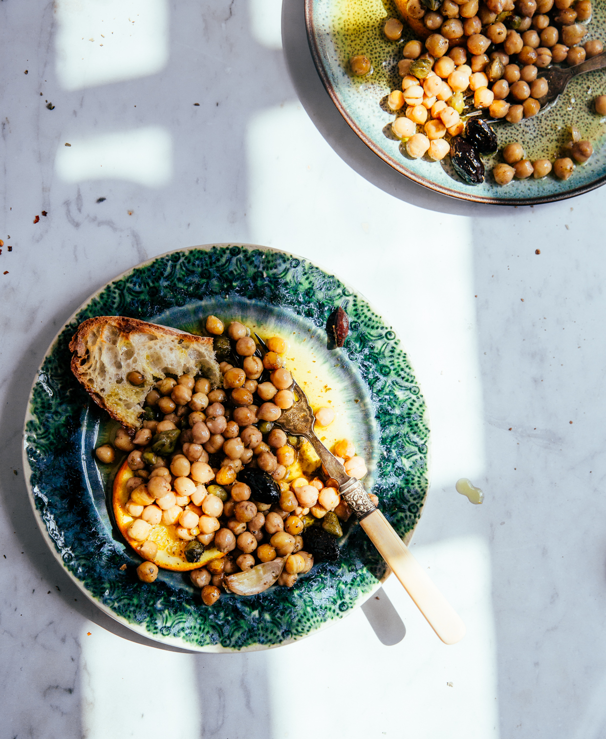 Baked chickpeas with capers, olives & orange
